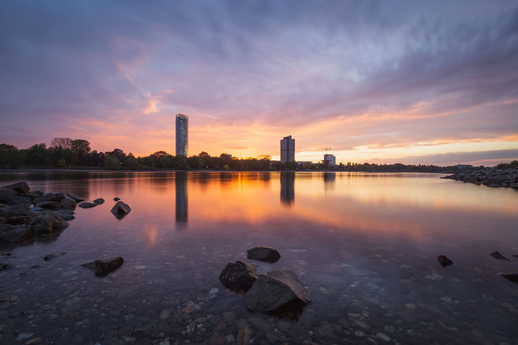 The River Rhine and the the city of Bonn, Germany, at sunset Sky Water Sunset Reflection Cloud - Sky Nature No People Orange Color Idyllic Outdoors Bonn Germany Rhein Rhine Rhine River Rheinufer Long Exposure Purple Copy Space NRW Skyscraper Dhl