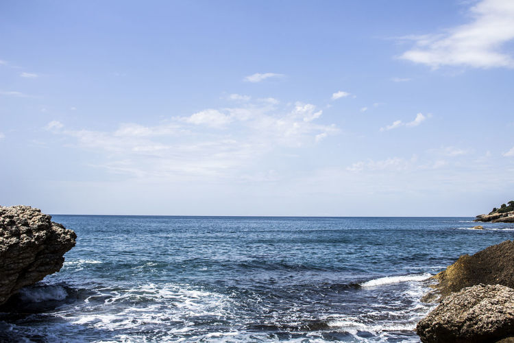 Water Beauty In Nature Nature Outdoors Sea Sky Horizon Rock Rock - Object Land Horizon Over Water Beach Day No People Motion