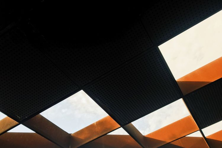 Low angle view of modern building ceiling