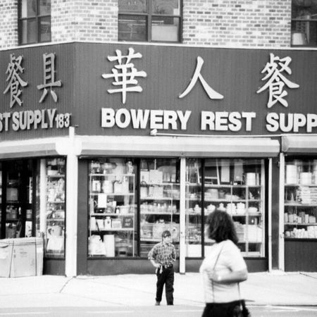 China Town New York Adult Architecture Bowery Building Exterior Built Structure Business City City Life Communication Day Men Outdoors People Rear View Sign Store Street Text Walking Western Script Women