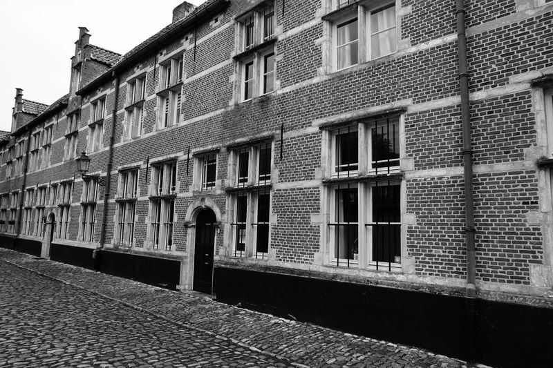 Window Architecture Building Exterior Built Structure Outdoors Day No People City Sky Black & White Black And White Monochrome Historical Building Architectural Tourism Old House Brick Building Bricks Street Vintage Facades Front EyeEm Gallery Architecture_collection