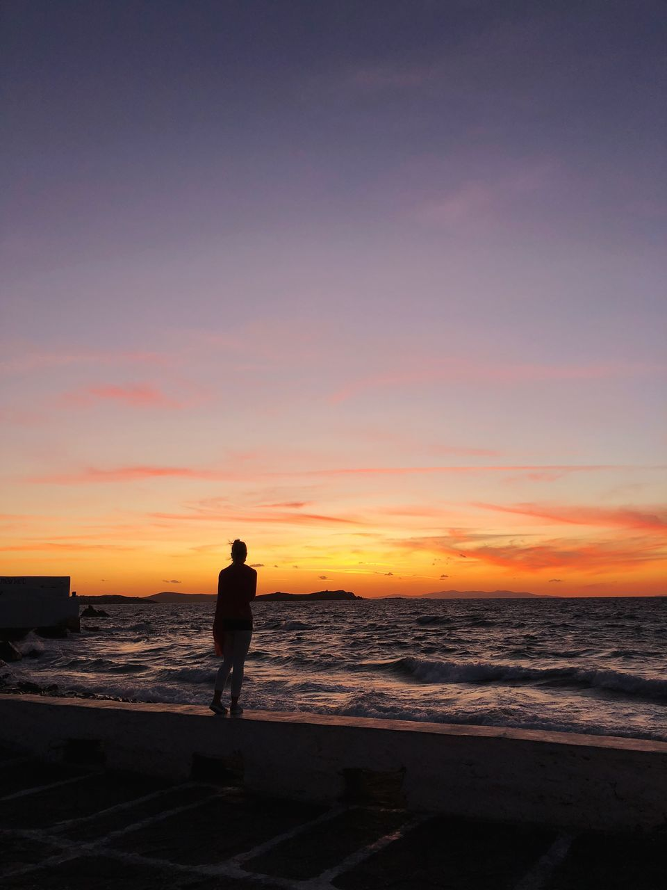 sunset, sea, beach, silhouette, water, one person, shore, full length, horizon over water, nature, beauty in nature, real people, leisure activity, standing, scenics, men, walking, sky, outdoors, lifestyles, sand, wave, one man only, people
