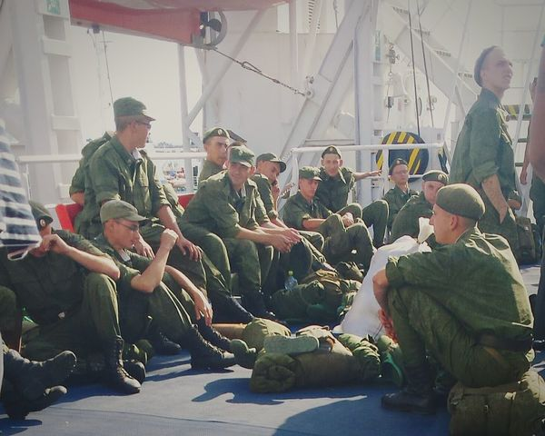 Ship Soldiers Soldier People Sitting People Sitting Talking Men Man Human Humans Green First Eyeem Photo Sky Boat