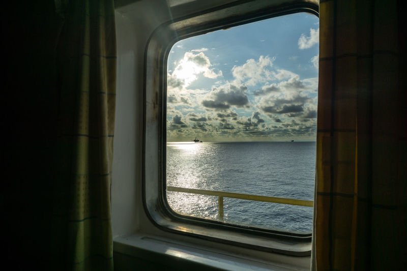 a window with sea view Offshore Life Day Morning Ocean Platform Upstream Glass Offshore Oil And Gas Oilfield Cloud Cloudy Cabin Horizon Water Sea Window Looking Through Window Sky Cloud - Sky Travel See Through Boat