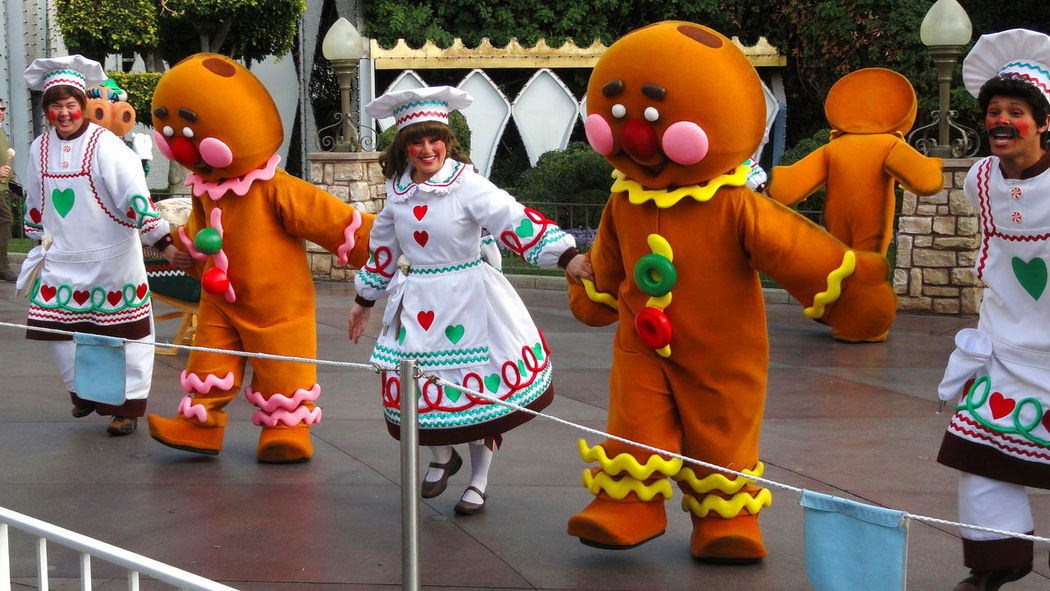 Childhood Creativity Day Disneyland California Gingerbread Men Human Representation In A Row Large Group Of Objects Man Made Object Multi Colored Outdoors Parade Repetition Retail  Vibrant Color