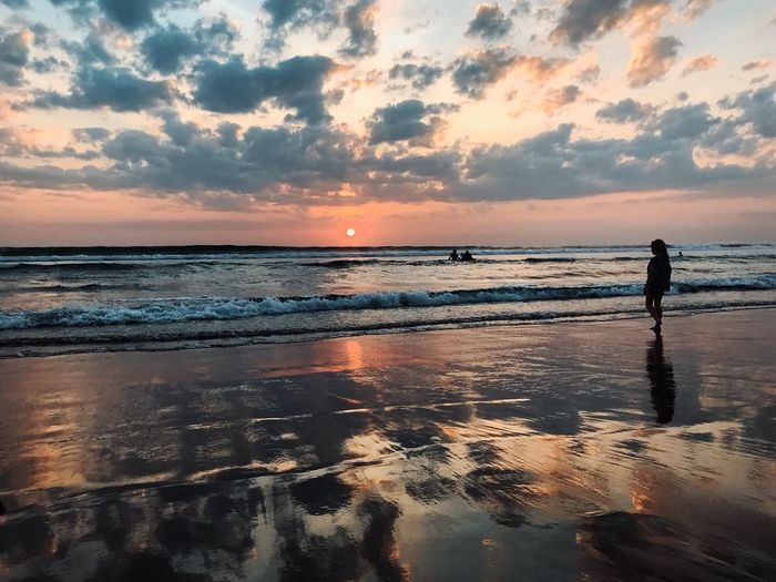 All we are chasing is a beautiful sunset Beach Water Sky Sea Land Sunset Beauty In Nature One Person Reflection Nature Lifestyles Horizon Tranquility Silhouette Real People Leisure Activity Scenics - Nature Horizon Over Water Cloud - Sky Outdoors