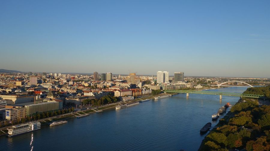 High angle view of river and buildings against clear sky