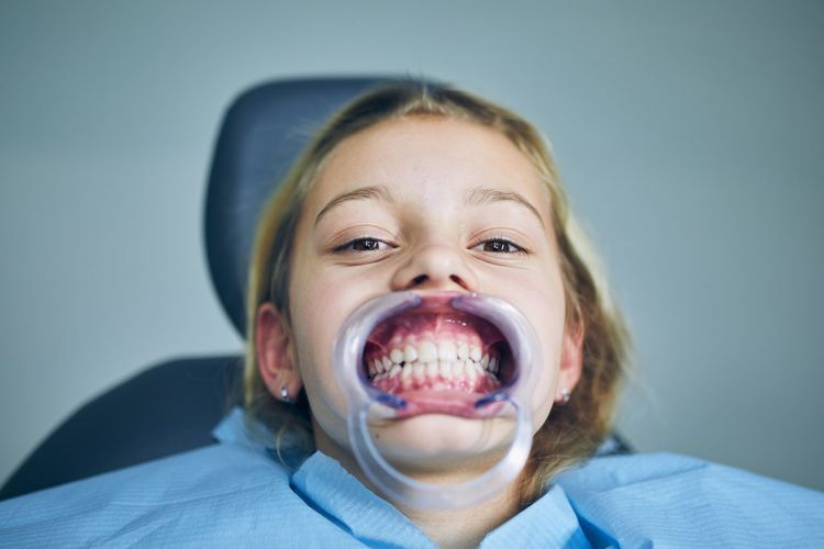 Close-up portrait of girl at dentist office