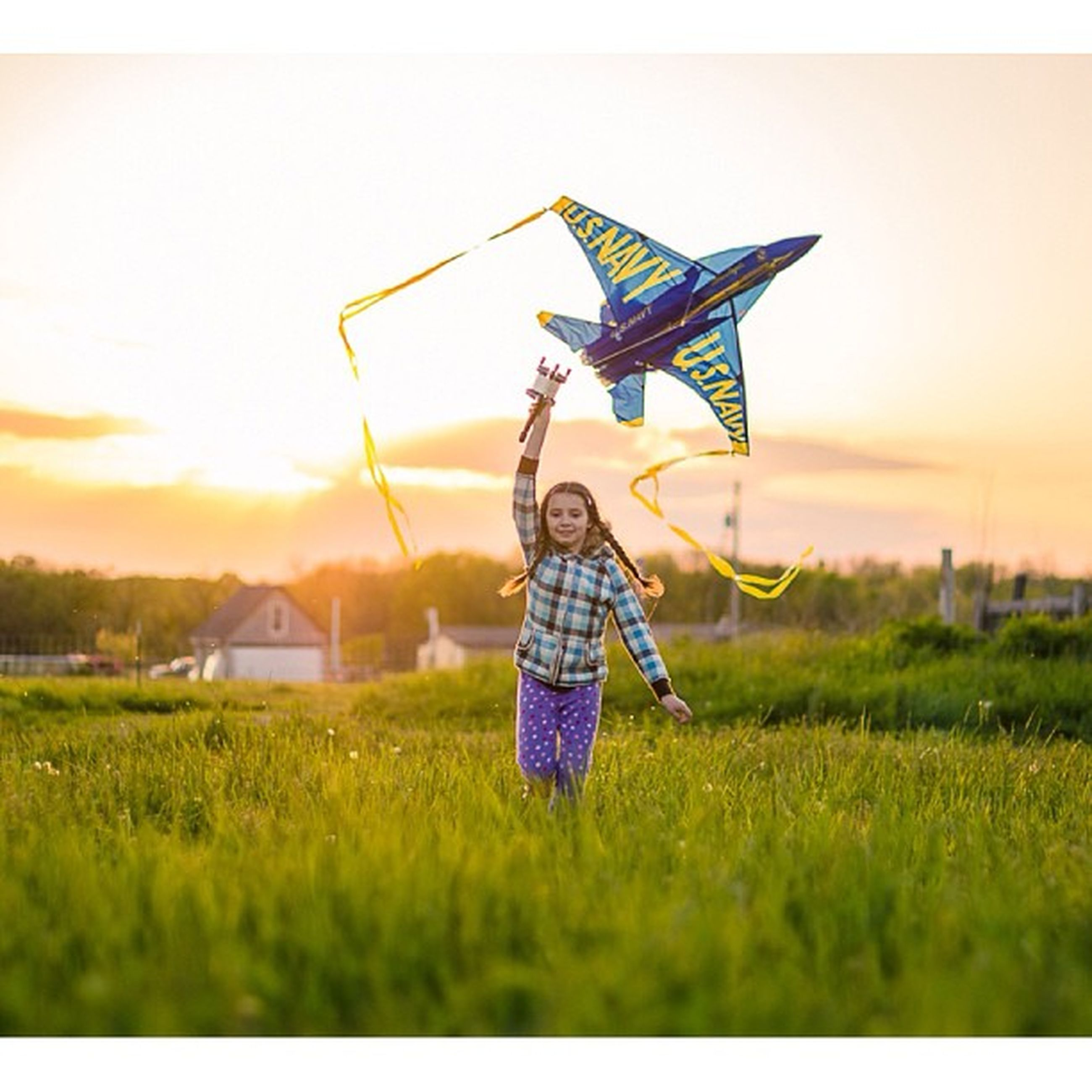 grass, field, grassy, leisure activity, sky, lifestyles, landscape, full length, mid-air, auto post production filter, enjoyment, standing, transfer print, casual clothing, green color, sunset, outdoors, nature