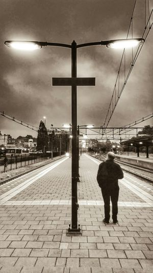 Waiting For A Train to come. Early Morning on Railway Station Groningen. Light And Shadow in Monochrome Sepia