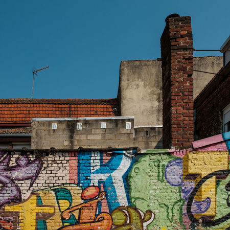 Architecture Brick Brick Wall Building Building Exterior Built Structure Day Graffiti Low Angle View Multi Colored Mural Sky Street Art Wall Wall - Building Feature