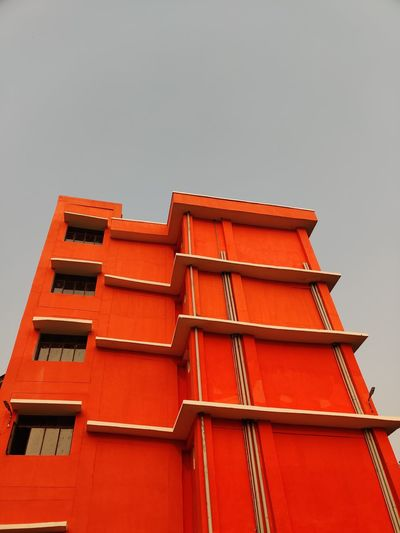 Low angle view of red building against clear sky