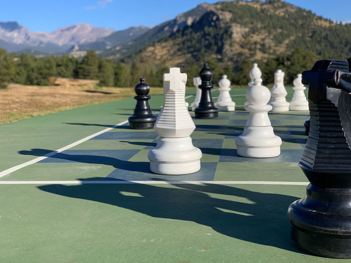 Full frame shot of chess pieces on mountain