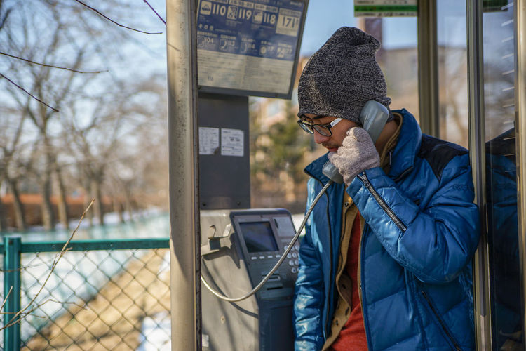 Asian  Calling Cold Temperature Day Jacket Japan Miss Missing One Person Payphone Phonebooth Public Telephone Real People S Talking Warm Clothing Winter Young Adult