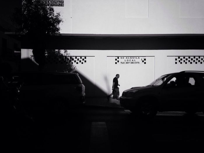 Silhouette of car on road in city