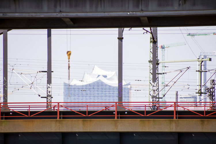 Elbphilharmonie by bridge against sky