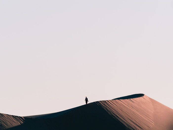 A lone person walks a top a massive sand dune in the ancient Mungo National Park Australia Australian Landscape Minimalist Architecture Nature Adventure Minimal Nature Minimalism Nature One Person Outdoors Sand Dune Scenics - Nature Silhouette Sky Unrecognizable Person Week On Eyeem Summer Exploratorium The Traveler - 2018 EyeEm Awards The Great Outdoors - 2018 EyeEm Awards A New Beginning