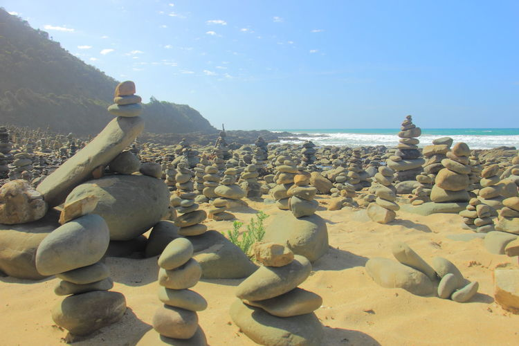 Thousands stone stack arrangements on the beach of Carrisbrook Creek is the sight of bewildering wonder along the Great Ocean Road,in Victoria, Australia. Australia Australian Landscape Carrisbrook Creek Great Ocean Road Great Ocean Road, Australia Travel Victoria Australia Australia & Travel Beach Horizon Over Water Manmade Stone Stacks No People Roadtrip Rock - Object Sand Scenics Sea Travel Destinations