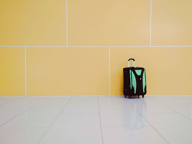 I should clean my bag Airport Life Airport Alone Travel Traveling No People Yellow Indoors  Day Bag Baggage Minimalism Minimalobsession Minimalist Traveling Home For The Holidays