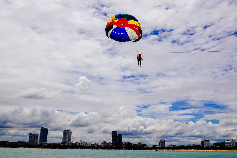 Beauty In Nature Cloud Cloud - Sky Cloudscape Cloudy Cumulus Cloud Day Extreme Sports Flying Mid-air Multi Colored Nature Outdoors Paragliding Scenics Sea Sky Tranquil Scene Tranquility Waterfront Weather Wide Shot