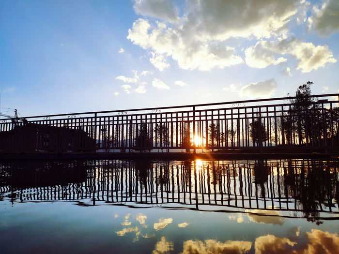 The reflection Reflection Water Sunset Lake Bridge - Man Made Structure Silhouette Sunlight Reflection Sun Reflecting Pool Blue