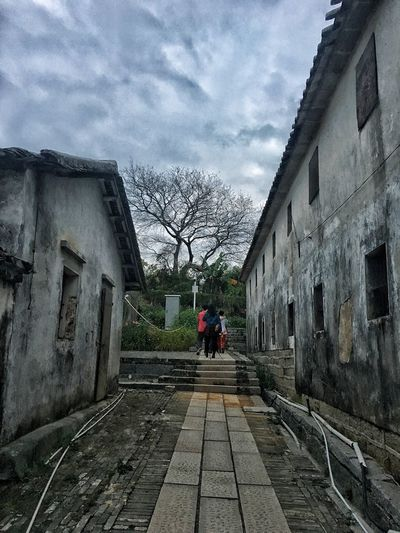 Built Structure Building Exterior Architecture Real People Lifestyles Men Sky Outdoors Day The Way Forward Rear View One Person Bare Tree Tree Cloud - Sky First Eyeem Photo Chinese New Year Spring Festival Chinese Building Cloudy Sky Cloudy Day Cloudy Building Freshness