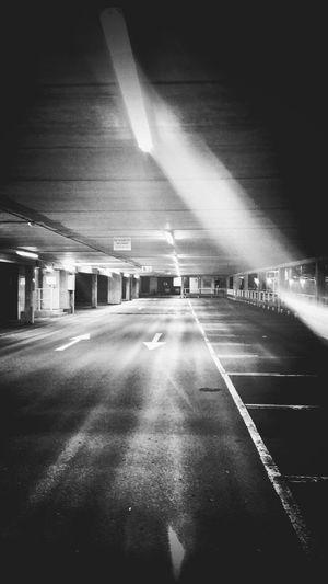 Road passing through illuminated tunnel
