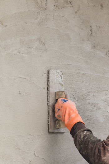 High angle view of man working on concrete wall