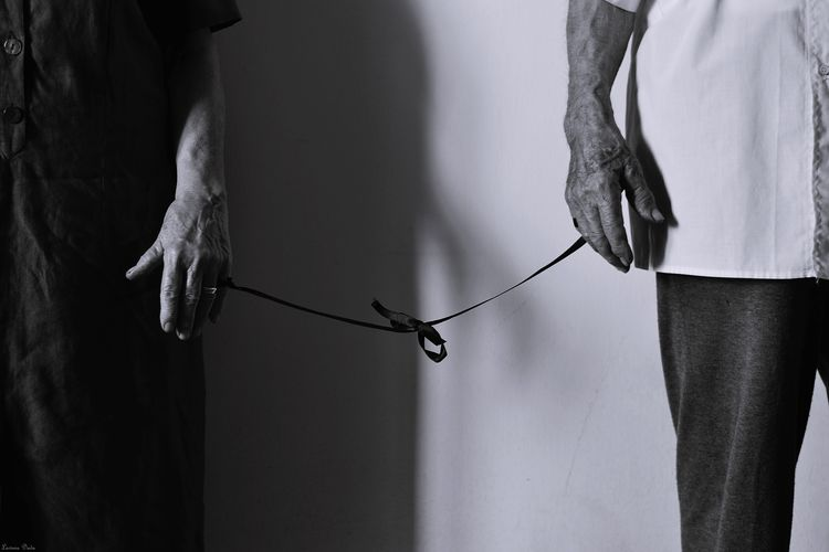 Senior woman and man tied together