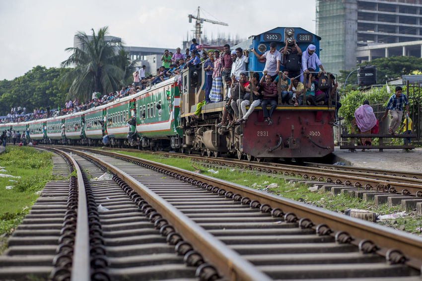 Thousands riding the roof of a train at Airport Railway Station in Dhaka , Bangladesh on 09 September, 2016 to celebrate the Eid-ul-Azha with their families back home in towns and villages. Eid-ul-Azha holidaymakers overcrowded the Airport Railway Station in Dhaka , Bangladesh on 09 September, 2016. Bangladesh Dhaka, Bangladesh Eid Eid Journey Eid Mubarak Festival Muslim Train Train Journey