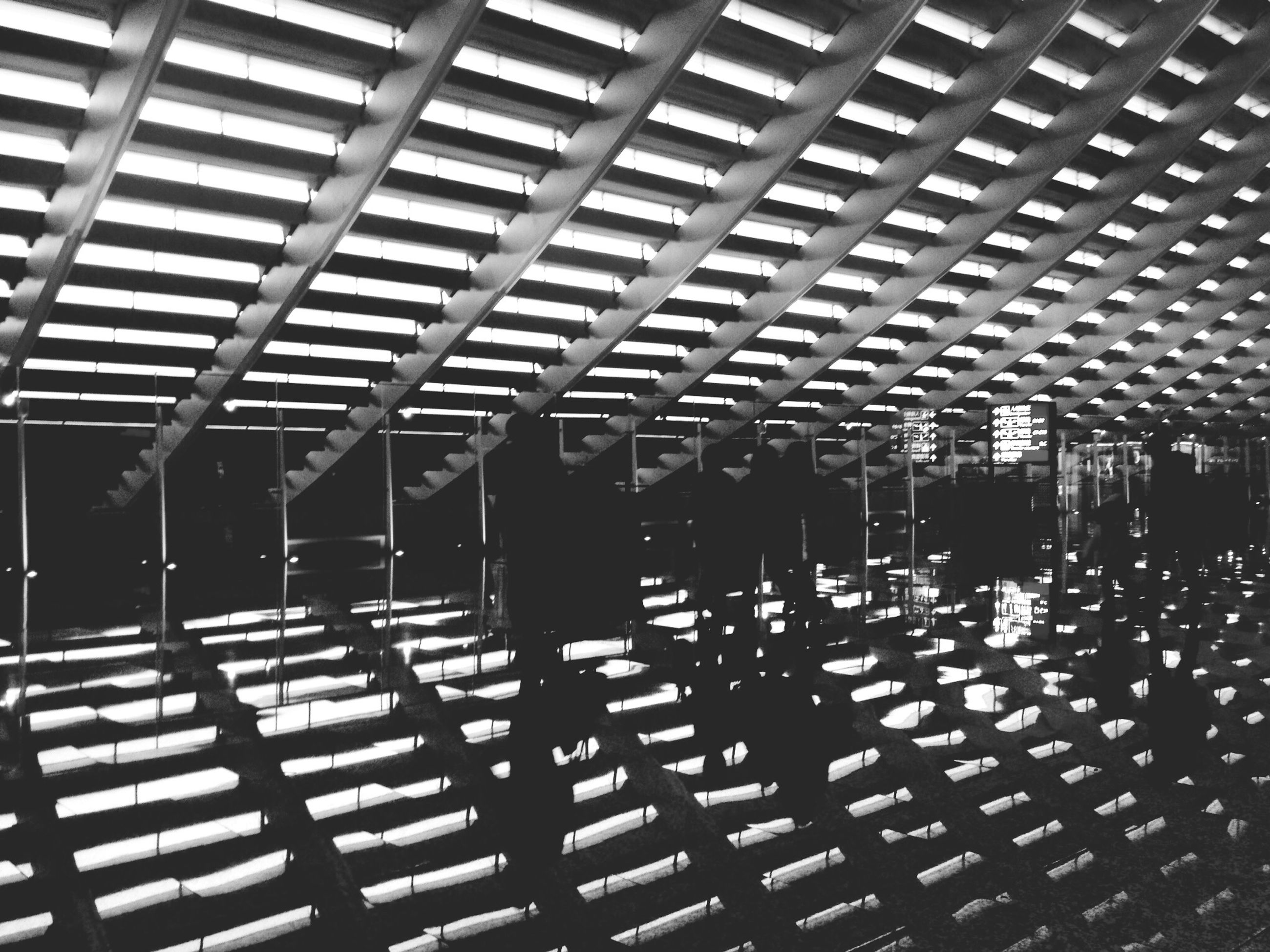 chair, indoors, empty, repetition, pattern, in a row, shadow, absence, seat, built structure, sunlight, bench, architecture, large group of objects, ceiling, arrangement, day, full frame, wood - material, table