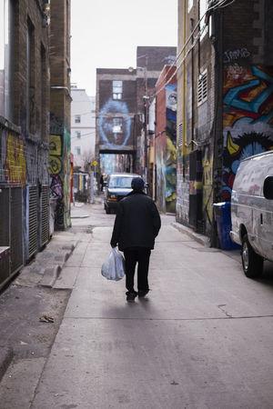 Up Close Street Photography Fujifilm Fuji X-T1 35mm Toronto Graffiti Queen West Street