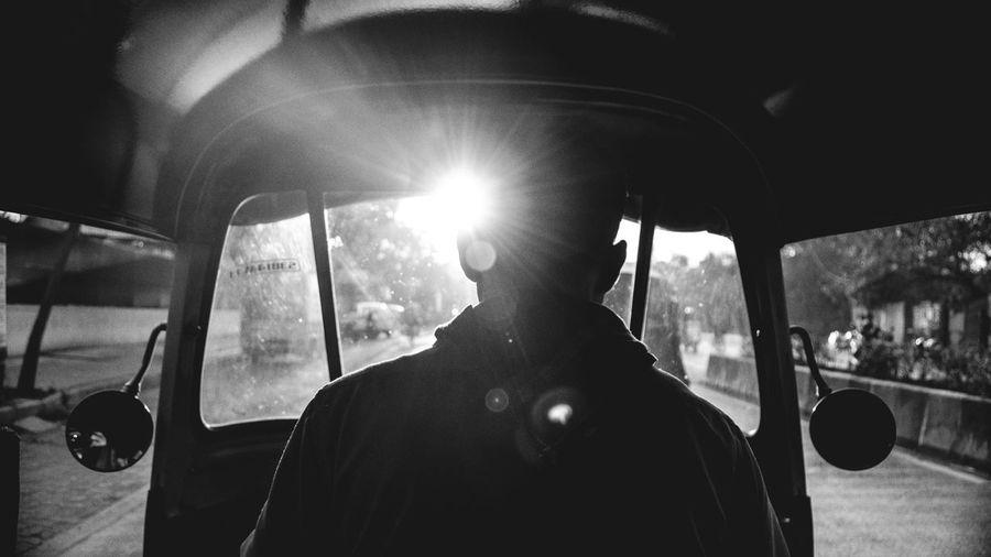 Man driving auto rickshaw