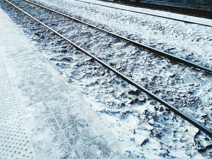 Closeup of railway platform and rails in winter Railway Railwaystation Platform Winter Travel Rails Backgrounds Full Frame Pattern Day No People Outdoors Textured  Close-up Nature Shades Of Winter Business Stories