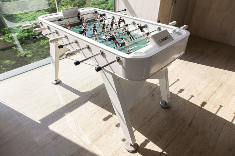 Modern White Table football. Sunlight Nature Day Shadow High Angle View Flooring Outdoors No People Wood - Material Absence Relaxation Sunny Faucet Table Plant Leisure Activity Tile Group Of Objects Group Clean Tiled Floor Luxury Table Football Board Lifestyle Modern Minimal Active Enjoying Life Players White Background Team Play