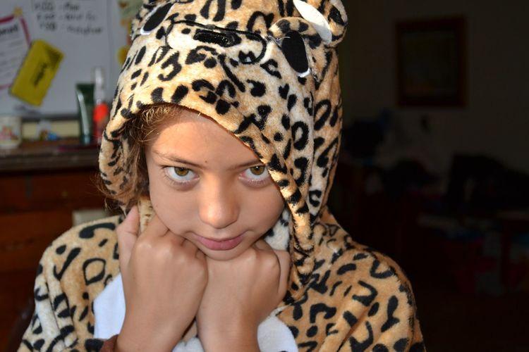 Close-up portrait of teenage girl wearing costume
