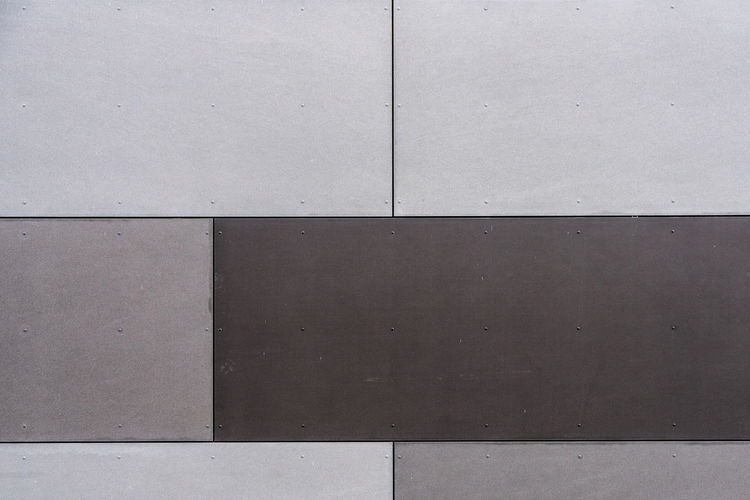 Brown gray background, wall of a house Brown Gray Backgrounds Wall - Building Feature Full Frame Architecture Built Structure Pattern Gray No People Day Geometric Shape Building Exterior Flooring Close-up Shape Concrete Outdoors Wall Textured  Blank Brown Tile White Color