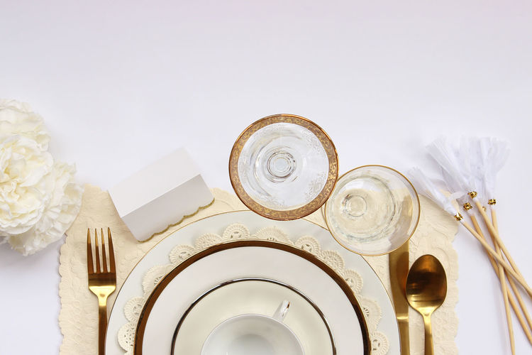 Chic white and gold table setting Border Chic Concept Dinner Party Dishes Elegant Etiquette Fancy Food And Drink Formal Frame Gold Colored Luxury Manners Meal Menu Mock Up Party Reception Restaurant Silverware  Styled Table Setting Top View Wedding
