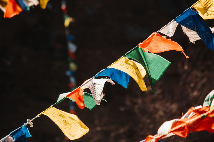 Close-up of multi colored flags on umbrella