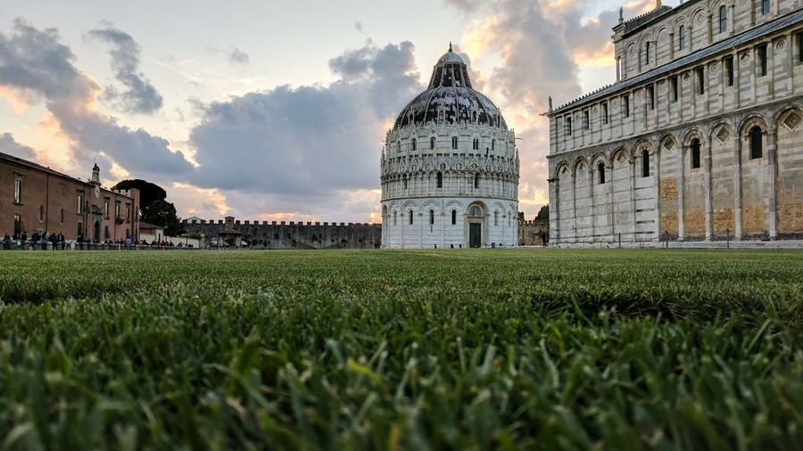 Piazza dei miracoli against sky during sunset in city