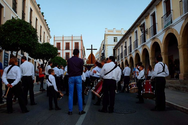 A religious procession pauses in the streets of Ronda, Spain. Travel Traveling Travel Photography Religion Catholic Catholicism Cross Symbol SPAIN Ronda Andalucía Fiesta Procession Crucifix Streetphotography Street Photography Documentary Low Angle View Street Religious  Christianity Community Party Drums Band