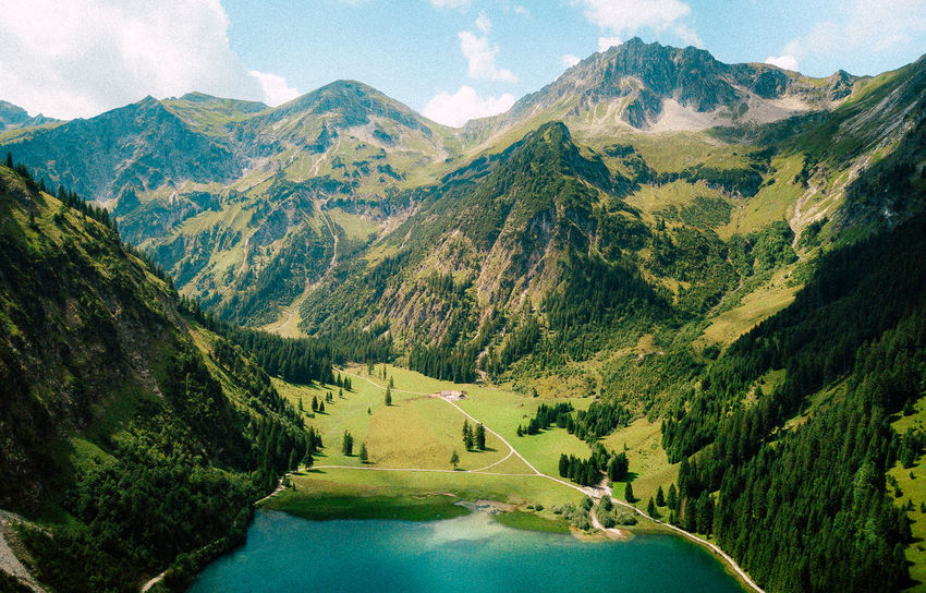 Drone  Sky And Clouds Travel VSCO Beauty In Nature Day Dji Dronephotography Grass Journey Landscape Mavic Mountain Mountain Range Nature No People Outdoors Road Scenics Sky Tranquil Scene Tranquility Tree Water Fresh on Market 2017 Lost In The Landscape Been There. Go Higher