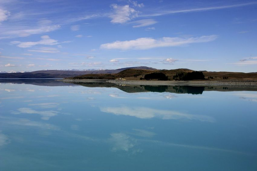 A view across Lake Pukaki, New Zealand New Zealand Landscape Peaceful View Travel Photography Beauty In Nature Blue Cloud - Sky Day Lake Lake Pukaki Nature No People Outdoors Reflection Scenics Sky Tourist Destination Tranquil Scene Tranquility Water Waterfront