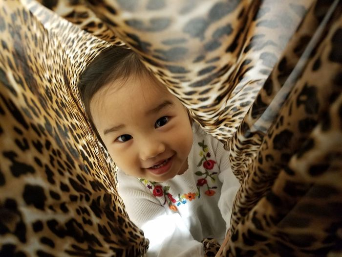 One Girl Only Little Girl Peek-a-boo Portrait Childhood Headshot Child Lying Down Cute Bed Baby Toddler  High Angle View Wrapped In A Blanket Leopard