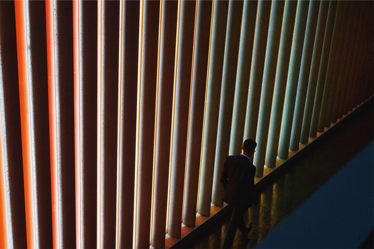 High angle view of businessman walking in corridor