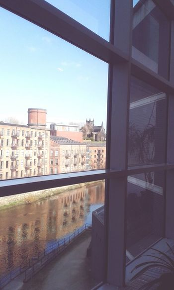 Cityscapes Leeds, looking out from the royal armouries museum Leeds City Water Window Lookingout Royal Armories Reflecting River Buildings
