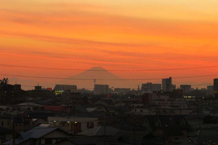 Cityscape against orange sky