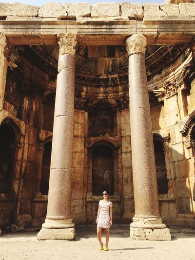 Rear view of woman standing in front of building