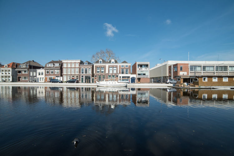 Reflections @ Gouda (1) Architecture Built Structure Building Exterior Building Water Reflection Sky House Residential District Nature Day Waterfront No People Blue City Outdoors Cloud - Sky Luxury Travel Destinations Row House Canal