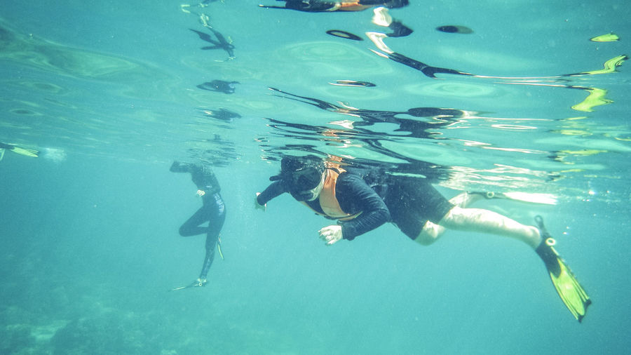 Underwater Water Sea Swimming UnderSea Adventure Sport Aquatic Sport Exploration One Person Nature Diving Equipment Leisure Activity Scuba Diving Diving Flipper Snorkeling Real People Lifestyles Underwater Diving Marine
